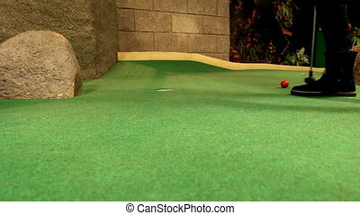 Girl playing golf indoor