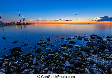 Sister Bay Sunset - A glowing sunset sky illuminates the...