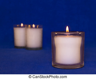 Group of three memorial yahrzeit candles - Jewish custom is...