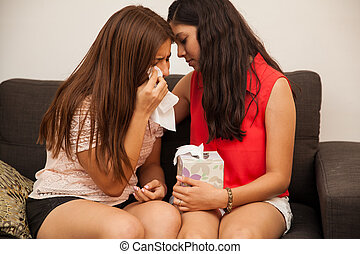 Comforting my best friend - Hispanic teenager comforting her...