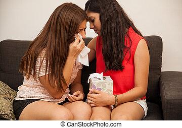 Comforting my best friend - Hispanic teenager comforting her...