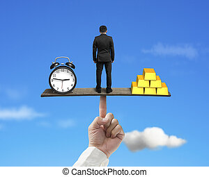 standing person between clock and gold balancing on finger...
