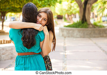 Hugging my best friend - Cute teenage brunette hugging her...