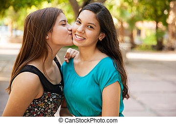 Kissing my best friend - Beautiful Hispanic teen kissing her...