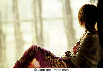 Portrait of thinking woman looking out