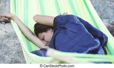 Girl wakes up in hammock