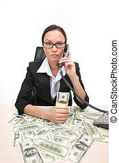 Closeup of businesswoman looking at camera and holding...