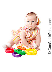 Child  girl  playing with educational toy color pyramidion  isol