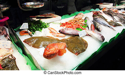 fish displayed at a fish market - view of fish displayed at...