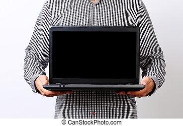 Closeup portrait of a businessman holding laptop