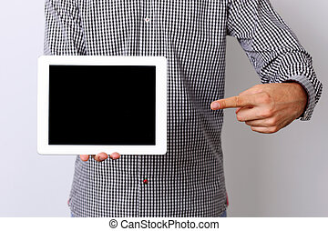Closeup portrait of a male hand pointing on the tablet...