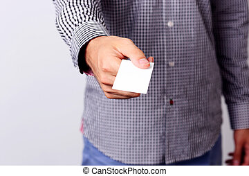 Closeup portrait of a male hand giving blank credit card