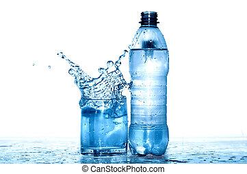 Mineral Water - Glass of splashing water near plastic...