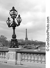 Street lantern on the Alexandre III Bridge with Eiffel Tower...
