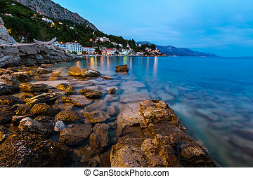 Rocky Beach and Small Village near Omis in the Evening,...
