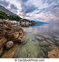Rocky Beach and Small Village near Omis in the Morning,...