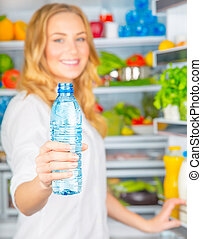 Healthy nutrition concept - Soft focus of happy girl holding...
