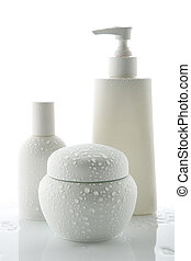 lotion bottles - Three white cosmetic bottles with water...