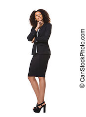 Business woman thinking and looking up - Full length...