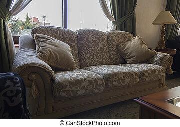 elegant antique sofas with big cushions