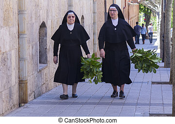MADRID,SPAIN - APRIL 4:Nuns walking down the street prepared...
