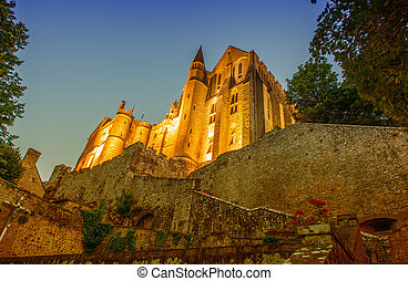 The Mont Saint Michel Abbey at dusk in Lower Normandy, France