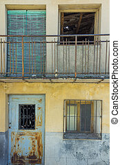 background of old small house with terrace doors and windows