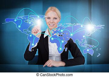 Businesswoman Touching Connected World Map - Portrait of...