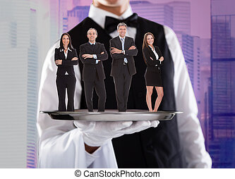 Business People On Silver Tray Being Carried By Waiter -...