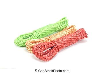 bundles of colorful nylon ropes on white background