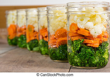 Jars of cut vegetables for canning - Jars of fresh cut...