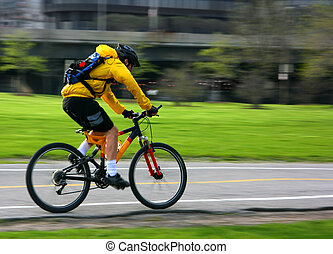 Mountain bike pan - Young man speeding on a mountain bike