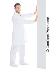 Doctor Pushing Something Over White Background