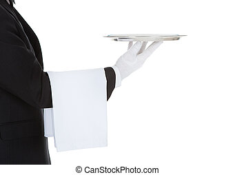 Cropped Image Of Waiter Holding Empty Tray - Cropped image...