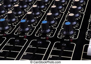 Mixer Close-up - Analog studio sound mixer closeup with...
