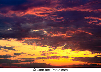Beautiful fiery orange and purple sunsetBeautiful fiery...