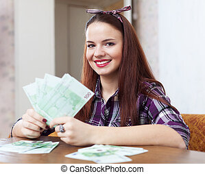 woman with many euro in home - Portrait of happy woman with...