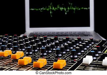 Sound Mixer - Analog studio sound mixer closeup with laptop...