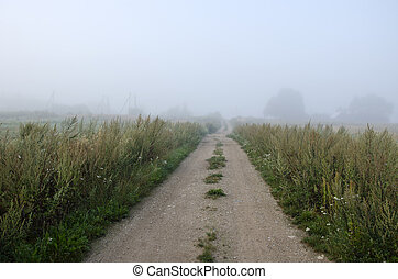 rural morning gravel road and mist
