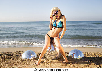 sexy blonde beach woman - a sexy blonde woman poses on the...