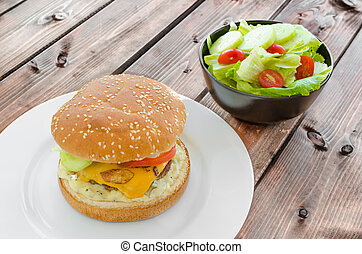 Cheeseburger with bacon and tartar sauce and garden salad...