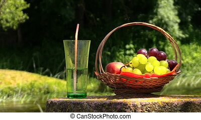 fruits and drinks - Wicker basket with grape and peach...