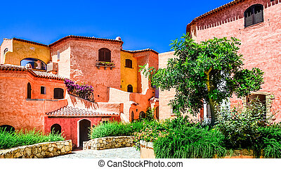 Beautiful colorful houses with nice garden in Sardinia -...