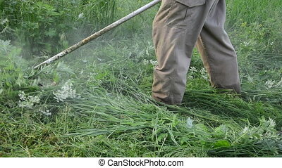 man trimmer cut grass - Turn view man gardener with trimmer...