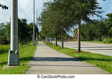 Sidewalk view on Livingston Rd in naples florida - Looking...