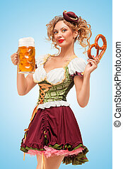 Serving beer and snacks. - Young sexy Oktoberfest waitress...