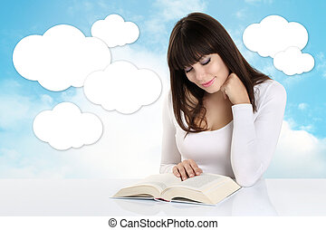 girl absorbed in reading a book on background with sky and...