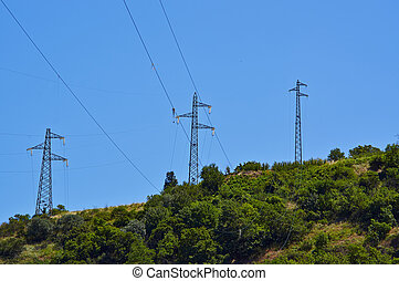 High-voltage tower Electric powerlines on the blue sky