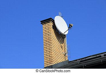Tv satellite dish on  chimney.