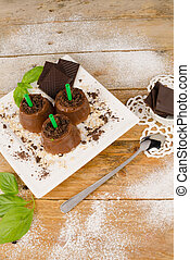 Chocolate pops - Plate with homemade chocolate popsicles, a...